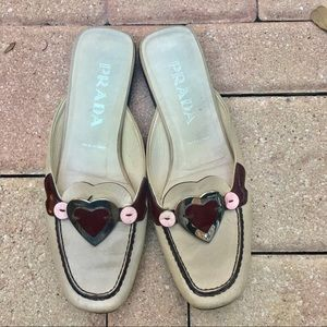 Prada tan and heart mules